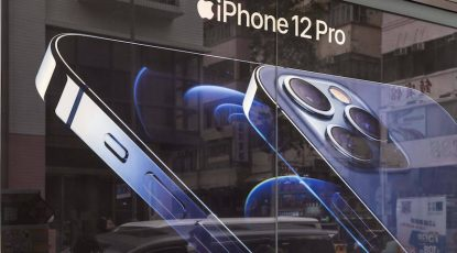 November 10, 2020, Hong Kong, China: A woman communicating on a phone walking past an American multinational technology company Apple Iphone 12 Pro advertisement in Hong Kong. Hong Kong China - ZUMAs197 20201110_zab_s197_057 Copyright: xBudrulxChukrutx